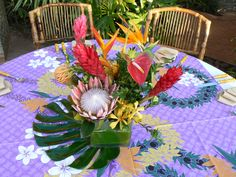 Tropical Cube Centerpieces for a luau at home. www.kuolanifloral.com