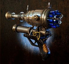 Ray gun built from found objects.  used flashlight parts, night vision accumulator, glass vials, colored liquid, a clock key, clock gears, kerosene torch parts, chromed decanter parts, nerf gun grip, leather, etc. It took over a month to build.  from the TheArtOfSpirit on Etsy