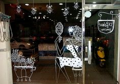 Gorgeous shop window painting. Boutique shop window display ideas. Had to share