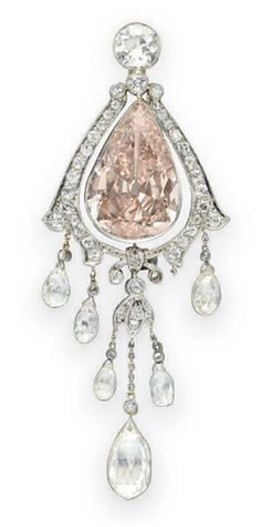 A BELLE EPOQUE COLORED DIAMOND BROOCH   Centering upon a bezel-set pear-shaped fancy brownish pink diamond, weighing approximately 5.83 carats, within an old mine-cut diamond scalloped surround, topped by a bezel-set old European-cut diamond, the bottom suspending briolette-cut diamond drops with single-cut diamond foliate detail and and collet-set diamonds, mounted in platinum, circa 1910, (one briolette-cut diamond drop deficient)