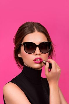 Carpe diem. Seize the day with a hot pink look and retro style Bobbi Brown sunglasses.