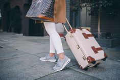 Gal Meets Glam Travel Style - Nike sneakers, Frame jeans and Steamline Luggage carry-on
