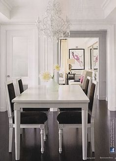Love the dark floor, white table, black and white chairs combination.