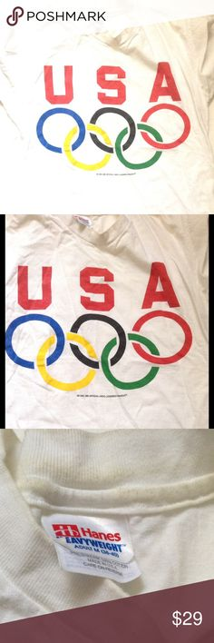 "🆕 1990's USA OLYMPIC RINGS T-Shirt Adult Med A Piece Of History!!  Vintage 90's USA OLYMPIC RINGS Men's T-Shirt  Colored rings with USA in block letters.  Hanes Brand   Below logo: ""36 USC 360 Official USOC Licensed Product""  Size Medium 38-40  Shirt displays signs of wear, use and age. No wash-wear.   ☘Shirt is sold as is and Nonrefundable and non-returnable. ☘PLEASE READ CLOSET POLICIES PRIOR TO PURCHASE☘ Vintage Shirts Tees - Short Sleeve"