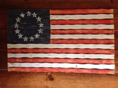 Wooden flag hanging on our log home.