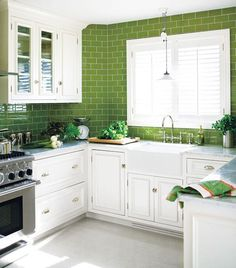 Kitchen with white cabinets and green subway tile to the ceiling - love the subway tile