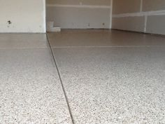 Troweled in joints looking smooth with a polyaspartic coating. Garage Floor Coatings, Tile Floor, Concrete, Smooth, Flooring, Tile Flooring, Wood Flooring, Floor