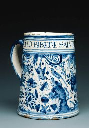 1638, probably Pickleherring Quay pottery, Southwark Of straight-sided tapering form with loop handle, the rim inscribed DILVCVLO BIBERE SALVBERRIMUM EST . SI MOD above a broad band of 'bird-on-a-rock' decoration with insects and birds in flight and perching on rocks on a ground of stylised flowers, foliage and scrolls (Christies)