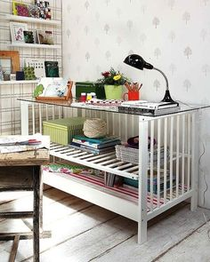 Turn a crib into a table by adding a glass top.