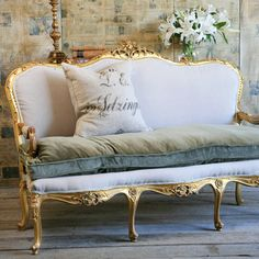 "look at this old french settee...overpainted in gold..extra pillow cusion in off grey..and fun pillow..add my favorite flower's ""lily's""..its me!!!"