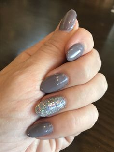 Grey nails with holographic glitter nail accent. Hard gels