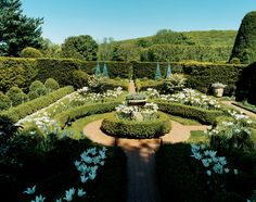 White Triumphator and Queen of Night tulips in full bloom in one of Oscar de la Renta's garden rooms; the walls are of yew and the beds are framed in box hedges. Oscar de la Renta's Country Home #garden