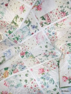 Baby or Lap Quilt, Round and Round The Garden,  Floral Vintage Sheets. $95.00, via Etsy.