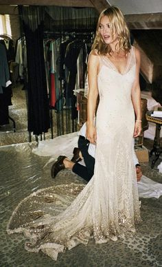 A close up look at Kate Moss's wedding dress. Yup, it's pretty much the most beautiful wedding dress I've ever seen. I love the gold detaili...