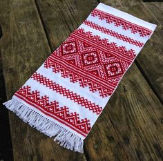 NEW HANDMADE EMBROIDERED TOWEL     UKRAINIAN RUSHNIK     Completely handmade    Rushniks are traditional East Slavic Towels, often decorated with the ornamental pattern.  Decorated rushniks are used for ceremonial events. An example of their use would be a host offering his guests bread and salt, which would then be served on a rushnik. Rushniks are also used at religious services, funerals, and other social functions. On each rushnik, there is a decorative pattern, an ornament. The…