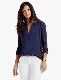 Must-have Henley crafted from mixed materials. Features a button-front closure, long sleeves with roll tab feature and hi-lo shirttail hem.<br/><br/>• 27.5 inches long <br/>• 31.5 inches long at sleeve