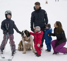Danish royal family are visited by a St Bernard as they play in the snow in Switzerland. Prince Frederik, his wife Princess Mary and their kids. Prince Christian 8, Princess Isabella 6, and twins Prince Vincent and Princess Josephine 3.