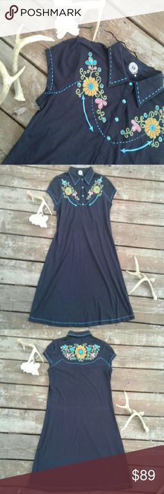 Double-D Ranch black collared, embroidered dress Double-D Ranch Wear, high end, embroidered, cap sleeve, Shirt dress. Gorgeous embroidery on chest and back, with embroidered edges in a pretty blue, and blue pearl snap buttons. Rhinestones throughout embroidery set off the bright colors. 95% cotton 5% Spandex, lightweight and comfy perfect for fall! The Cowgirls little black dress! Very good condition. This brand is in the same league as Spell / Free People / Johnny Was /Anthropologie. Approx…