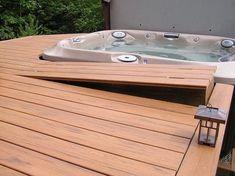 Hot tub deck with access hatch. Timbertech Tropical Teak composite decking with hidden fasteners around a hot tub. Located in Bellingham, WA Hot tub deck with access hatch. Hot Tub Backyard, Backyard Gazebo, Pergola Roof, Garden Gazebo, Whirlpool Deck, Sunken Hot Tub, Teak, Outdoor Spa, Wood Patio
