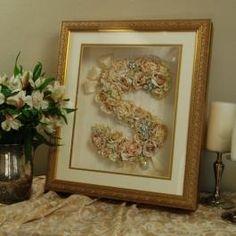 Floral Surname Monogram of Bride's Wedding Bouquet by www.ElegantGownPreservation.com .  Yes!  We preserve flowers, too!  We ship nationwide!  972-258-5815  1-855-214-1949