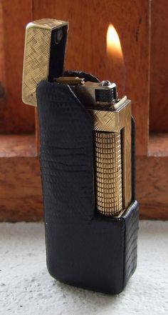 Buy A beautiful, working old gold filled DUNHILL rollagas lighter in elegant vintage leather coverfor R395.00