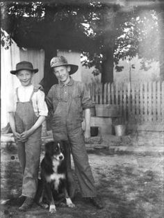 Two happy farm boys with their dog. 1890-1900 Albert J. Ewing (Photographer)