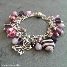 Pretty in pinks and mauve delicate butterfly charm bracelet #mauve #purple #pink #fromtheattic #bracelet #charmbracelet #jewellery #jewelry #fashion #accessories #beads #handmade #madeinuk #unique #giftsforher #jewellery #jewelry