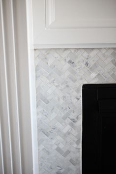 Carrara Marble Chevron Fireplace surround