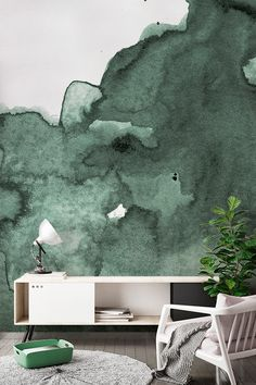 Wash away your worries with inky watercolor hues. This stunning wallpaper design captures smokey emerald tones that add allure and sophistication to your living room spaces. Pair with neutral furnishings for a totally relaxed feel. #wallpaper #murals #wallmurals #interior #interiordesign #design #home #homedecor #interiordecor #accentwall #inspiration #Ihavethisthingswithwalls