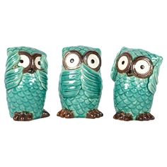Set of three turquoise ceramic owls.     Product: 3 Piece owl décor setConstruction Material: Ceramic