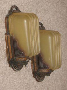 Art Deco bronze and tan glass slip shade sconces.