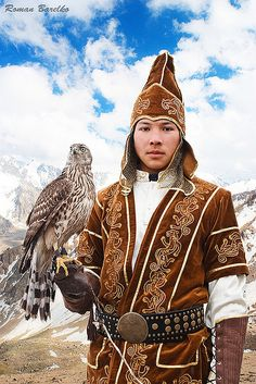 ( - p.mc.n.) Kazakh people living in Mongolia near Bayan-Olgii use golden eagles to hunt wild sheep, foxes and wolves, and get together once a year in October to show off and compete.