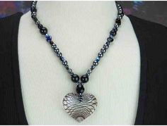 1/KIND Romantic and Unique Necklace features Genuine Onyx and Hematite!