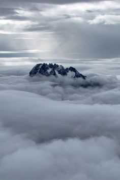 In The Clouds. Mawenzi Peak in the clouds from the Mount Kilimanjaro Summit in Tanzania, Africa | by Michael Mellinger on Flickr