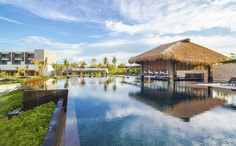 Opened in 2013, the NIZUC Resort & Spa on Design Locations is located 15 minutes from Cancun Airport in the exclusive enclave of Punta Nizuc, at the gateway of the Riviera Maya in Mexico. The hotel features an Adults Only as well as a Family Friendly pool. The 2800 m² NIZUC SPA by ESPA includes a comprehensive fitness center as well as both male and female hydrotherapy areas and offers Mayan inspired therapies dedicated to physical and spiritual well-being. The resort also features six..