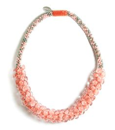 Coral Sands, Sky Necklace | $350 | Same Sky necklaces are handmade in Rwanda. The necklaces are crocheted with our signature handblown glass beads on a non-stretch cord, with smaller seed beads at the neck. Standard necklaces sit comfortably around the neck at 17.5 inches and fasten with a magnetic closure. Specific lengths and colors can be special ordered upon request.