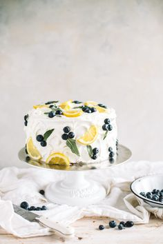Lemon Blueberry Cake with Lemon Buttercream Lemon blueberry cake with lemon buttercream! This layer cake is studded with fresh blueberries, filled with lemon curd and frosted with lemon buttercream. Food Cakes, Cupcake Cakes, Fondant Cakes, Spring Cake, Summer Cakes, Spring Party, Spring Desserts, Just Desserts, Spring Recipes
