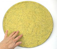Paleo Pizza Dough - - Here's a quick and delicious gluten-fee, grain-free pizza crust. It has a slightly crispy texture with a rich flavor of garlic and herbs. It's a snap to make, as this pizza dough recipe has no yeast. This saves time, so you can mix it, press it in the pan, and use it! I prefer a no-yeast pizza crust because it saves a lot of time. You can make this Paleo pizza crust recipe in either 12″ or 16″ size,