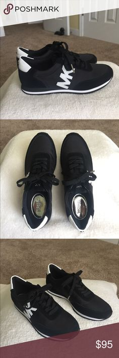 78f00f52e6b2 Shop Women s Michael Kors Black White size 6 Sneakers at a discounted price  at Poshmark.