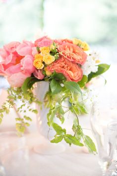 Coral colored #centerpiece | Photography: http://anniemcelwain.com | Floral Design: http://brownpaperdesign.com