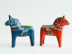 I am half Swedish...my Dad was born in Sverige and came to the US when he was two years old.   {swedish dala horses via Etsy}