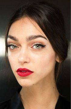 Red lips can be fresh and modern if moist (not glossy), worn with clean dewy skin and unfinished brows.