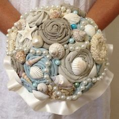 This sweet bridal bouquet is the perfect addition to your beach wedding. Fabric and lace rosettes in soft blues, taupes and creams are all hand cut and