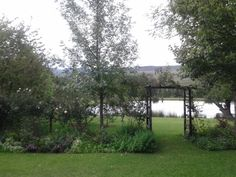 Beautiful cottage garden in Dullstroom, South Africa, overlooking a small dam.