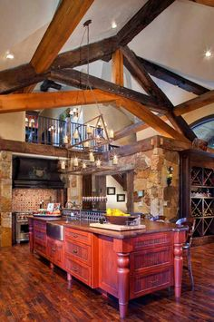 Reclaimed Timber Home - Timber Home Living-I like how there is a small opening to see down into the kitchen from upstairs and I like the timbers.