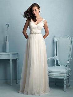Allure Bridals 9205 | This gown sweetly pairs lace and fluid tulle for an effortlessly beautiful bridal look.