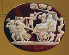 Roman cameo of Bacchus on a chariot pulled by Psyche. The cameo was made out of onyx and sardonyx and is dated from the 1st century A.D.