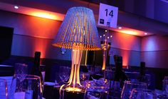 The Ritz Lamp Low , a contemporary centrepiece designed for lavish soirees. The lampshade captures the light beautifully and casts a sultry glow Led Centerpieces, Centrepieces, Decoration Piece, Table Centers, Low Tables, Recent Events, Modern Table, Glow, Chandelier