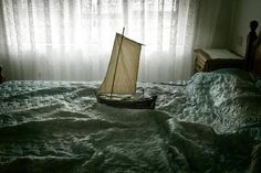Tiny Boats Sailing on a Sea of Bedsheets » Man Made DIY | Crafts for Men « Keywords: bedroom, bed, art, boat