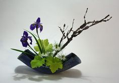 Moribana with iris, nigella, heuchera and euonymous